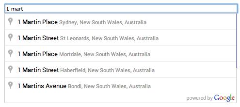 Bidang teks pelengkapan otomatis, dan daftar pilihan prediksi tempat yang disediakan saat pengguna memasukkan kueri penelusuran.